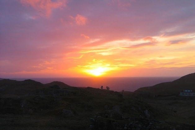 Sunset viewed from Mangersta Croft Wigwams