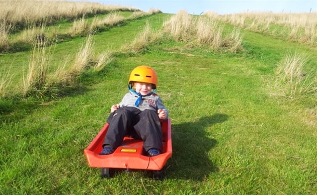 Grass sledging at The Loft