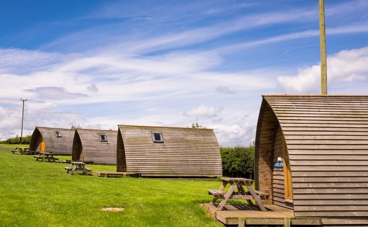 Row of Wigwams at Pot A Doodle Do Wigwam Village