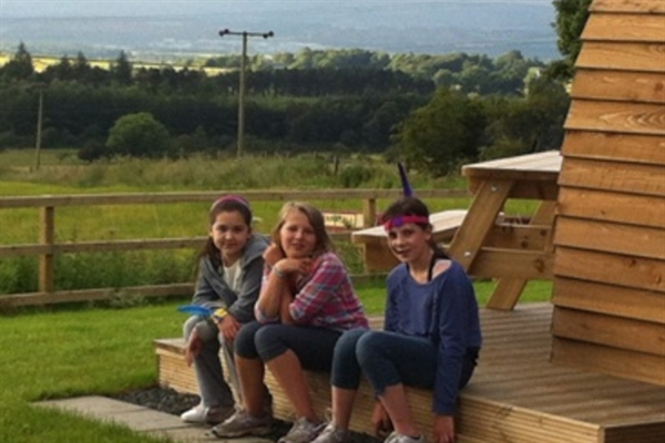 Girls chilling at Hilly Cow Wigwams
